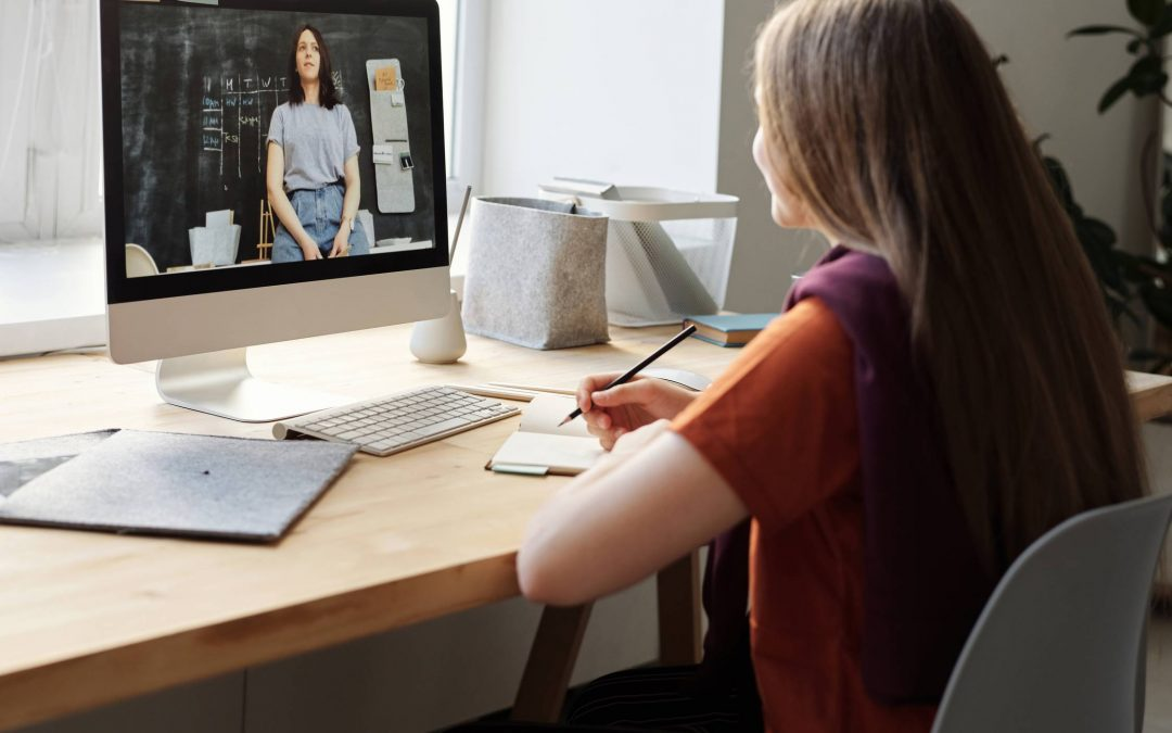 Young girl and teacher engaged in distance learning.